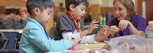 volunteers helping kids